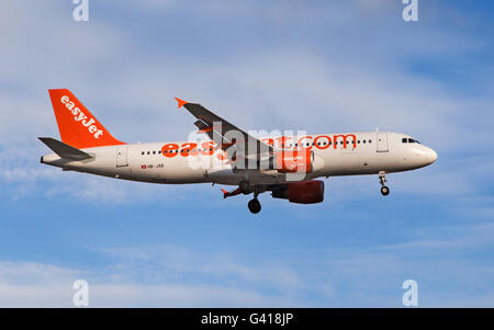 An EasyJet Switzerland Airbus A320-200 approaching to El Prat Airport in Barcelona, Spain. - Stock Photo