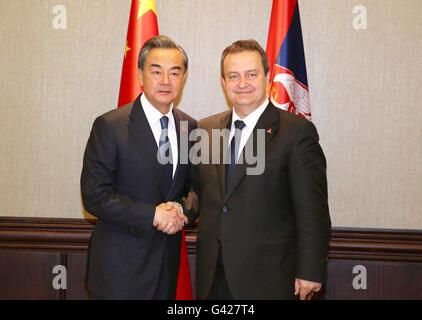 Belgrade, Serbia. 17th June, 2016. Chinese Foreign Minister Wang Yi (L) shakes hands with Ivica Dacic, Serbia's - Stock Photo