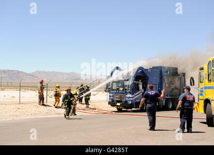 Las Vegas, Nevada, USA. 17th June, 2016. North Las Vegas Fire Department battle a garbage truck on fire at the Nevada - Stock Photo