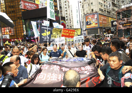 Hong Kong. 18th June, 2016.  Lam Wing-kee ( centre, man with a cap ) marched with pro-democracy lawmakers and thousands - Stock Photo
