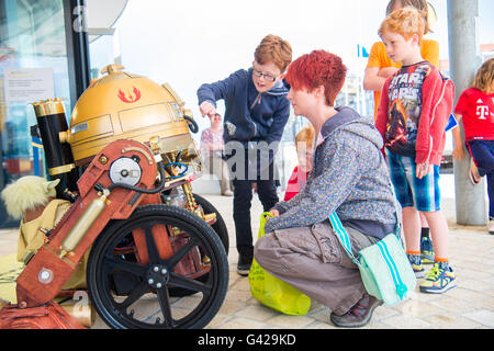 Aberystwyth Wales UK, Saturday 18 June 2016 Children interacting with a 'steam punk RD-D2' replica robot on a bright - Stock Photo