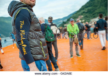 Lake Iseo, Italy. 18th June, 2016. A volunteer check people on The Floating Piers of Christo at Sulzano on June - Stock Photo