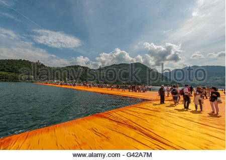 Lake Iseo, Italy. 18th June, 2016.  People walk on The Floating Piers of Christo on June 18, 2016 in Lake Iseo, - Stock Photo