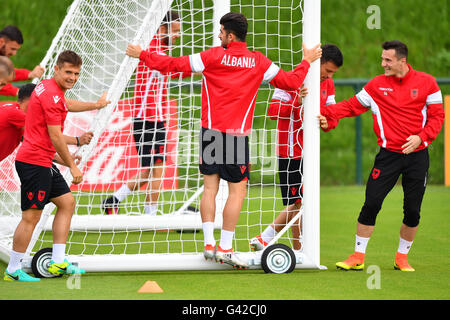 Taulant Xhaka (R) pushes a goal during a team training session at the transfer training ground Plaine de jeux de - Stock Photo