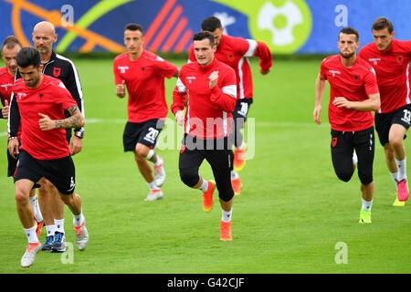 Taulant Xhaka (C) of Albania runs with team mates during a training session at the transfer training ground Plaine - Stock Photo