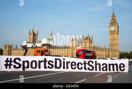 'Sports Direct shame' banner highlighting poor working conditions at Sports direct.The owner Mike Ashley appears - Stock Photo