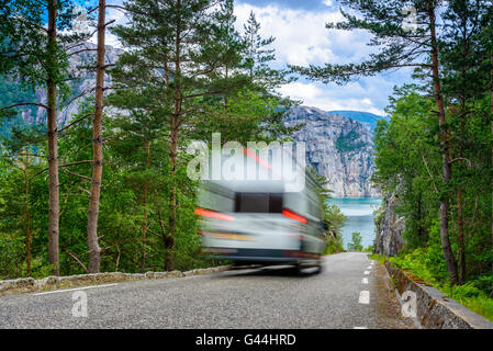 Fast vacation - an RV, motorhome passing by on a mountain road in Norway - Stock Photo