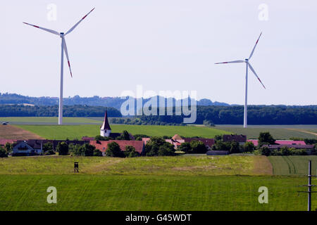 Wind turbines in rural residential area - Region Hesselberg, Bavaria/Germany - Stock Photo