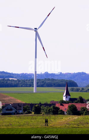 Wind turbine in rural residential area - Region Hesselberg, Bavaria/Germany - Stock Photo
