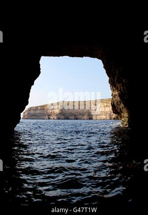 The journey through Gozo's limestone cliffs from the inland sea to the Mediterranean sea. - Stock Photo