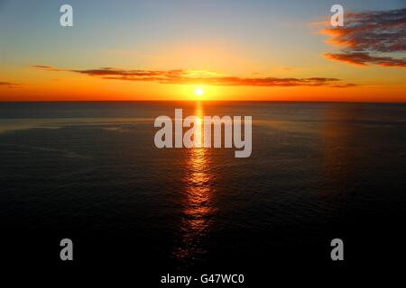 A sunset over Cardigan Bay. - Stock Photo