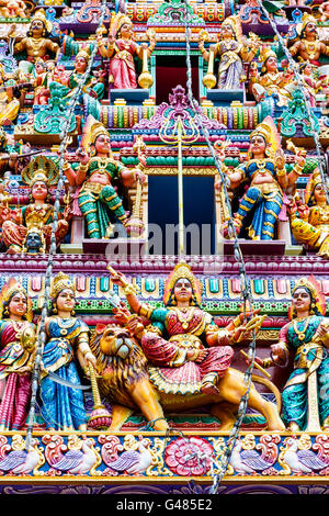 Intricate Hindu art and deity carvings on the facade of Sri Veeramakaliamman Temple in Little India, Singapore. - Stock Photo