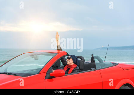 Relaxing woman on the beach in the car. Vacationor trip concept. - Stock Photo