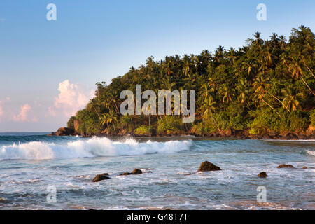 Sri Lanka, Mirissa, early morning waves at western end of beach - Stock Photo