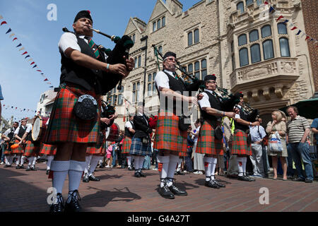 Scottish Parade With People Marching While Playing