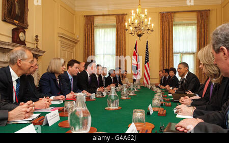 Prime Minister David Cameron (5th left) talks to US President Barack Obama (3rd right) at 10 Downing Street, London.