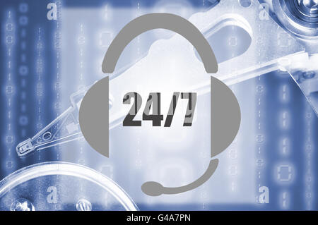 Image of an headset representing the concept of 24/7 support with an hard disk drive on the background - Stock Photo