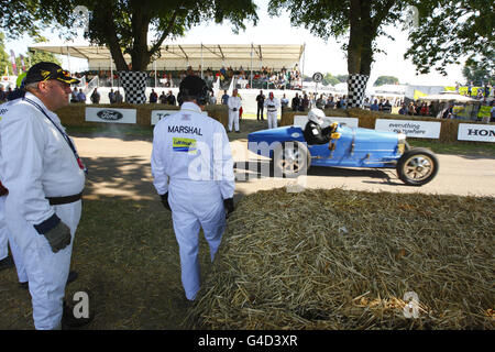 A car races up the hill at the Goodwood Festival of Speed near Chichester, West Sussex.