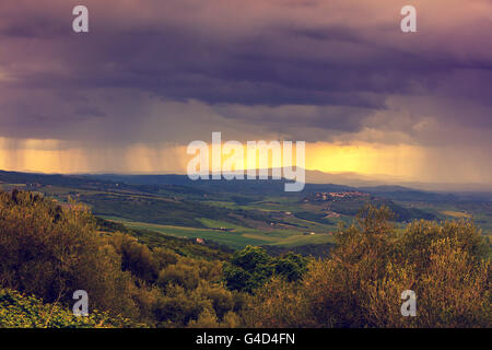 Tuscany valley in stormy weather at sunset, Italy - Stock Photo