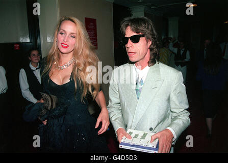 PA NEWS PHOTO 12/10/92  MICK JAGGER AND WIFE JERRY HALL LEAVE THE ROYAL ALBERT HALL AFTER ATTENDING THE CHELSEA - Stock Photo