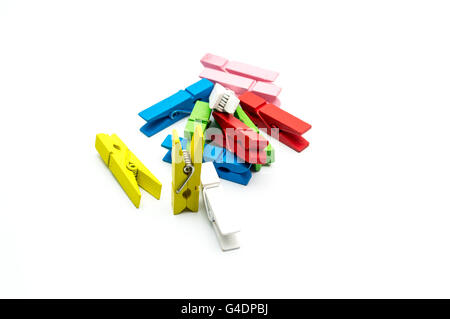 Colorful wooden clothespins isolated on white background - Stock Photo