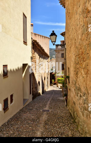 Medieval narrow street in Tossa de Mar, Spain, on May 24, 2016 - Stock Photo