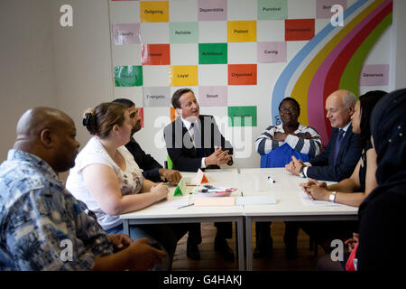 Prime Minister David Cameron and Secretary of State for Work and Pensions Iain Duncan Smith join a transferable - Stock Photo