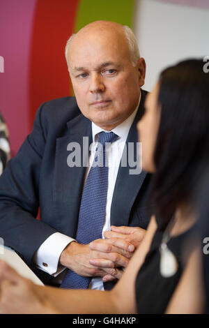 Secretary of State for Work and Pensions Iain Duncan Smith joins a transferable skills training session during a visit to the A4e (Action For Employment) offices in Brixton, south London.
