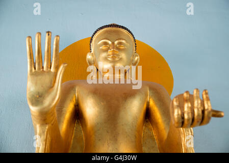 Standing Buddha gilded statue with hand mudra and halo, Shwezigon Pagoda, Nyanung-U, Mandalay Region, Myanmar - Stock Photo