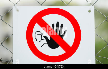 No Entry Sign on Wire Fence - Stock Photo