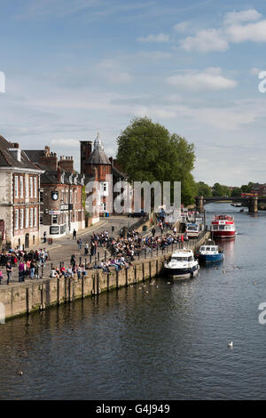 View over River Ouse and King's Staith with people enjoying a drink outside riverside pubs - York, North Yorkshire, - Stock Photo