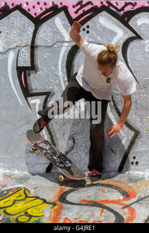 Graffiti & Spray Art grunge on the walls, ramps, and jumps of New Bird Skatepark, Liverpool, North West England, - Stock Photo
