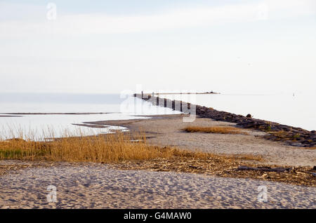 Pärnu breakwater during a hazy evening - Stock Photo