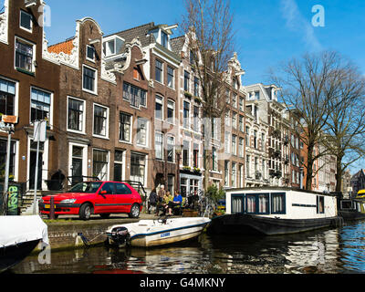 A view along one of Amsterdam's many canals on a beautiful spring day. - Stock Photo