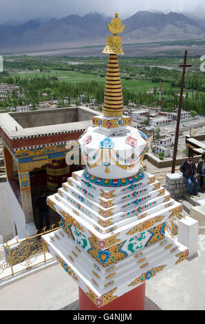 Stupa, or chorten, at Thikse Gompa near Leh, Ladakh, Jammu and Kashmir, India.  Indus valley in distance. - Stock Photo