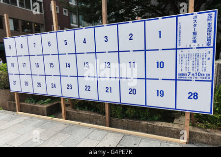 A poster board erected specifically for election ads ready to hold candidates' posters for July's House of Councillors - Stock Photo