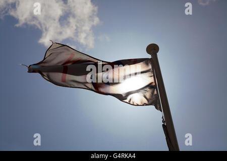 Royal national lifeboat institute flag against sky, England, United Kingdom, Europe - Stock Photo