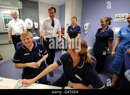 Prime Minister David Cameron and Secretary of State for Health Andrew Lansley (left) meet nurses during a visit to the Royal Salford Hospital in Manchester.