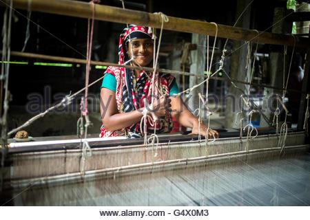 a women waving yarn  to make traditional saree in Tangail,Bangladesh. - Stock Photo