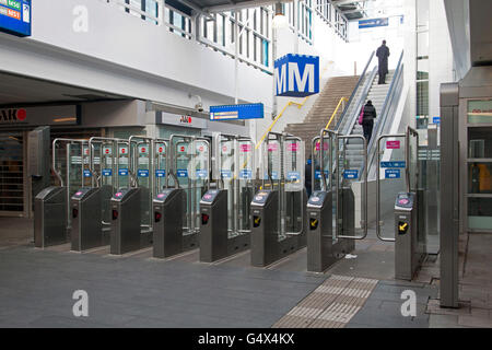 AMSTERDAM, HOLLAND - FEBRUARY 23, 2014: Check gates for the metro and train - Stock Photo