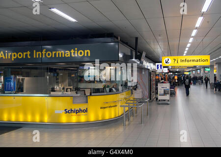 AMSTERDAM,HOLLAND - FEBRUARY 23, 2014: Passenger Information desk at Schiphol Airport - Stock Photo