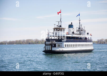 TORONTO - MAY 17, 2016: The Toronto Island Ferry connects the Toronto Islands in Lake Ontario to the mainland of - Stock Photo