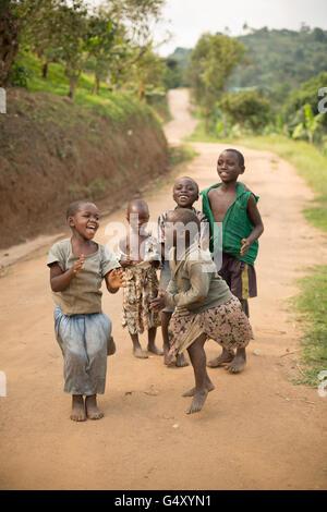 Happy children in rural Kasese District, Uganda, East Africa. - Stock Photo