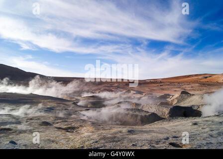 Bolivia, Steaming mud holes, salt desert, geysers of Sol de Mañana at 5000m - Stock Photo