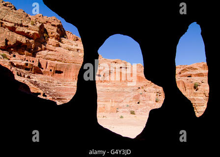 JORDAN, UNESCO world heritage archaeological site Petra, originally known as Raqmu to the Nabataeans, cave in sand - Stock Photo