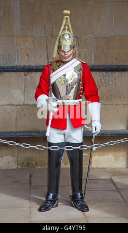 LONDON - APRIL 16: Unidentified men members of the royal guard nearby Whitehall palace on April 16, 2016 in London, - Stock Photo
