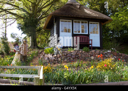 Thatched summer house at Halsway Manor - Stock Photo