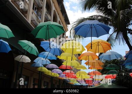 Umbrellas at Caudan Waterfront, Port Louis, Mauritius - Stock Photo