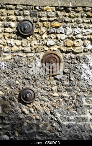 Patress plates on a stone layered wall in Hove, East Sussex - Stock Photo