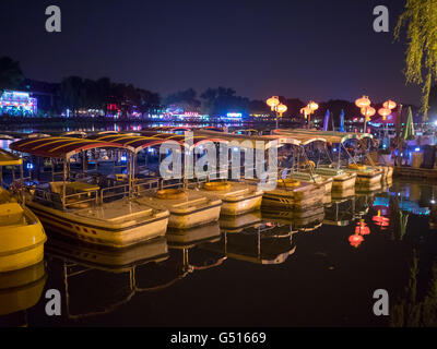China, Beijing, boats on the Qianghai Lake at night - Stock Photo